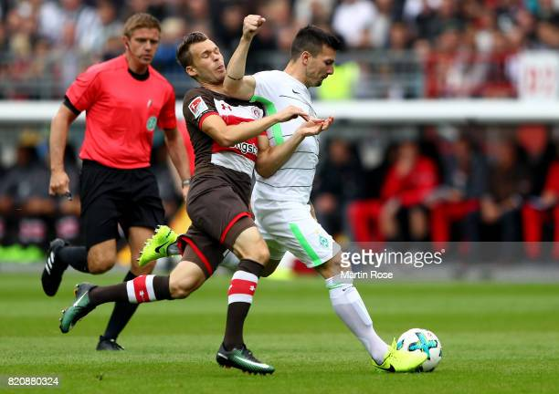Christopher Buchtmann of St Pauli and Jerome Gondorf of Bremen battle for the ball during the preseason friendly match between FC St Pauli and Werder...