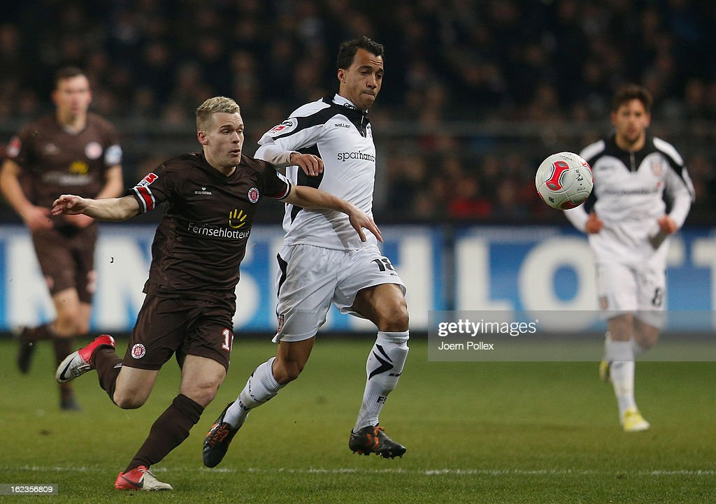 Christopher Buchtmann of St. Pauli (L) and Moise Bambara of Frankfurt compete for the ball during the Second Bundesliga match between 1. FC St. Pauli and FSV Frankfurt 1899 at Millerntor Stadium on February 22, 2013 in Hamburg, Germany.