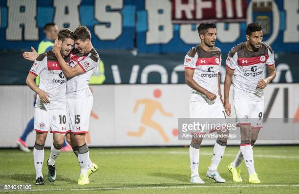 Christopher Buchtmann of St Pauli celebrates his team's first goal with team mates during the Second Bundesliga match between VfL Bochum 1848 and FC...