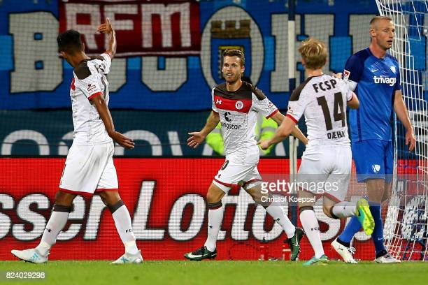 Christopher Buchtmann of St Pauli celebrates the first goal with Sami Allagui and Mats Moeller Daehli of St Pauli during the Second Bundesliga match...