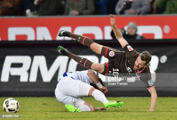 Christopher Buchtmann of St Pauli is challenged by Moritz Stoppelkamp of Karlsruher during the Second Bundesliga match between FC St Pauli and...