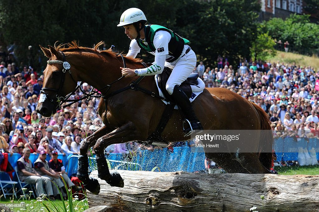 Christopher Burton of Australia riding HP Leilani negotiates a jump in the Eventing Cross Country Equestrian event on Day 3 of the London 2012...