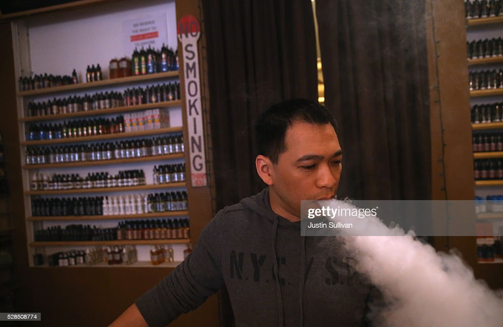 Christopher Chin blows vapor from an e-cigarette at Gone With the Smoke Vapor Lounge on May 5, 2016 in San Francisco, California. The U.S. Food and Drug Administration announced new federal regulations on electronic cigarettes that will be the same as traditional tobacco cigarettes and chewing tobacco.