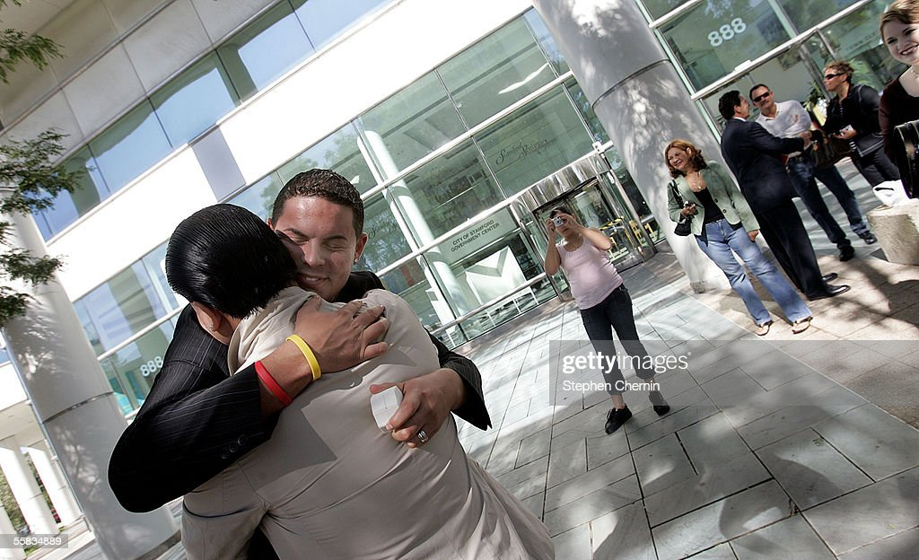Christopher Cintron hugs his partner Tristan Mogollon as friends and family look on after they were granted a civil union at Stamford town hall...