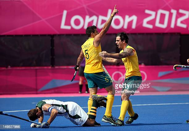 Christopher Ciriello and Kieran Govers of Australia celebrate after a goal against Austin Smith of South Africa during the Men's Hockey on Day 3 at...