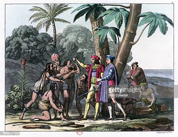 Christopher Columbus arriving in the New World 1492 Genoese explorer and navigator Columbus presenting gifts to the first natives to greet him on his...
