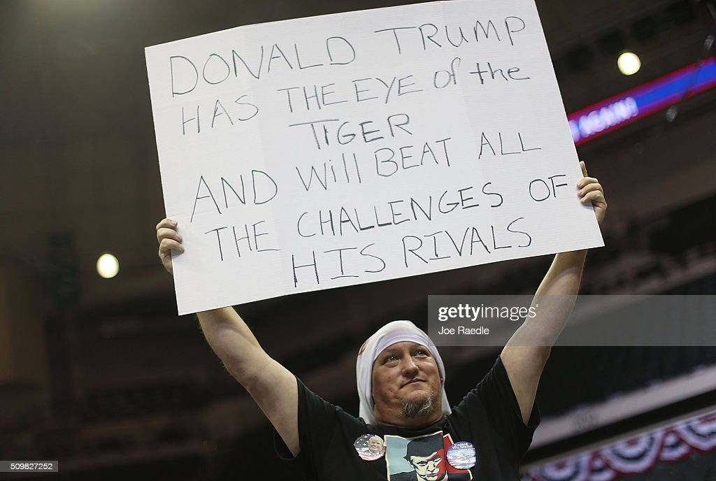 Christopher Cox shows his support for Republican presidential candidate Donald Trump as he waits for the start of a campaign rally at the University of South Florida Sun Dome on February 12, 2016 in Tampa, Florida. The process to select the next Democratic and Republican Presidential candidate continues.
