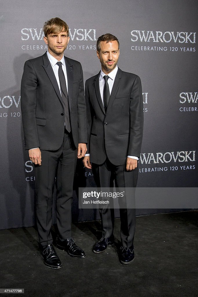 Christopher De Vos and Peter Pilotto pose for a picture on the 'black' carpet of the grand reopening of the Swarovski Crystal Worlds on April 28 2015...