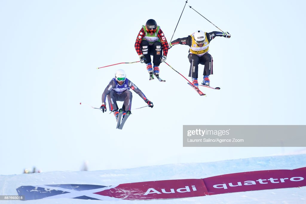 Christopher Delbosco of Canada takes 1st place, Arnaud Bovolenta of France takes 2nd place, Terence Tchiknavorian of France takes 3rd place during the FIS Freestyle Ski World Cup, Men's and Women's Ski Cross on December 7, 2017 in Val Thorens, France.