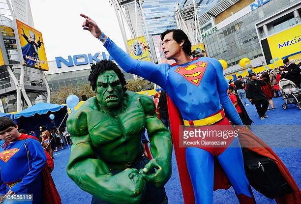 Christopher Dennis dressed as a costumed supehero Superman and Joe McQueen dressed as costumed superhero Hulk join over 1580 costumed superheroes to...