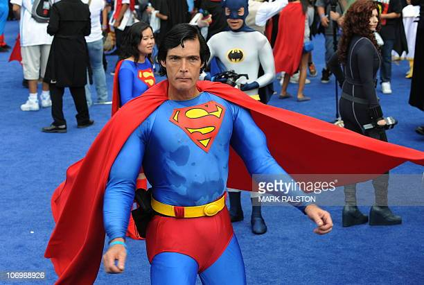 Christopher Dennis dressed as Superman joins the crowd of 1580 costumed superheroes during the successful attempt to break the Guinness World Record...