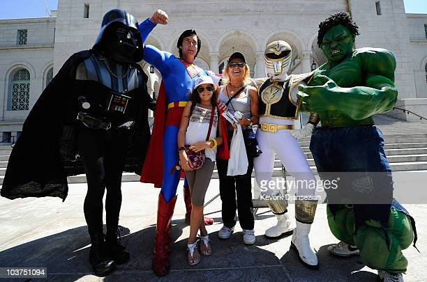 Costumed characters Darth Vader Superman The Hulk and The White Ranger pose with Italian tourists Giorgia Grillini and her grand mother Mara Busi...