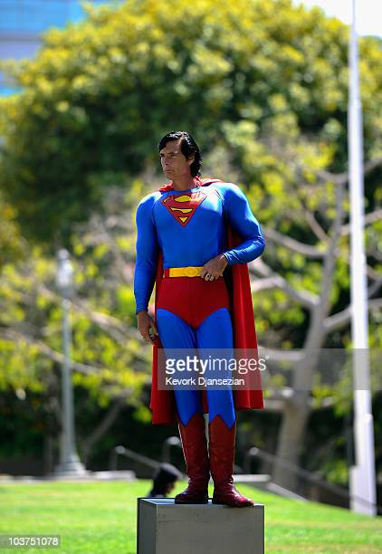 Christopher Dennis wearing a Superman super hero costume poses for a Craigs List TV cameraman during a protest with fellow costumed characters at the...