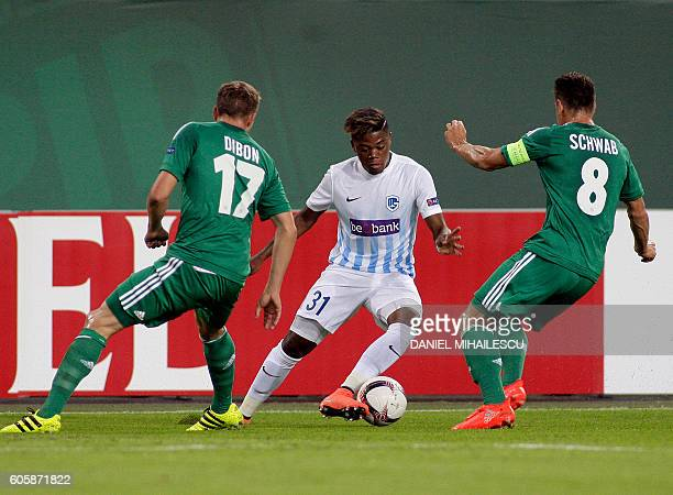 Christopher Dibon and Stefan Schwab of Rapid vie for the ball with Leon Bailey of Genk during the UEFA Europa League Group F football match Rapid...