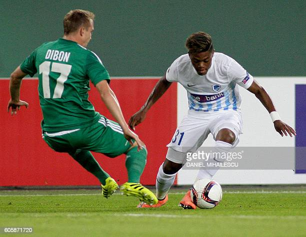 Christopher Dibon of Rapid and Leon Bailey of Genk vie for the ball during the UEFA Europa League Group F football match Rapid Vienna v Genk in...