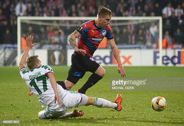 Christopher Dibon of SK Rapid Wien vies for the ball Frantisek Rajtoral of FC Viktoria Plzen during the UEFA Europa League football match FC Viktoria...
