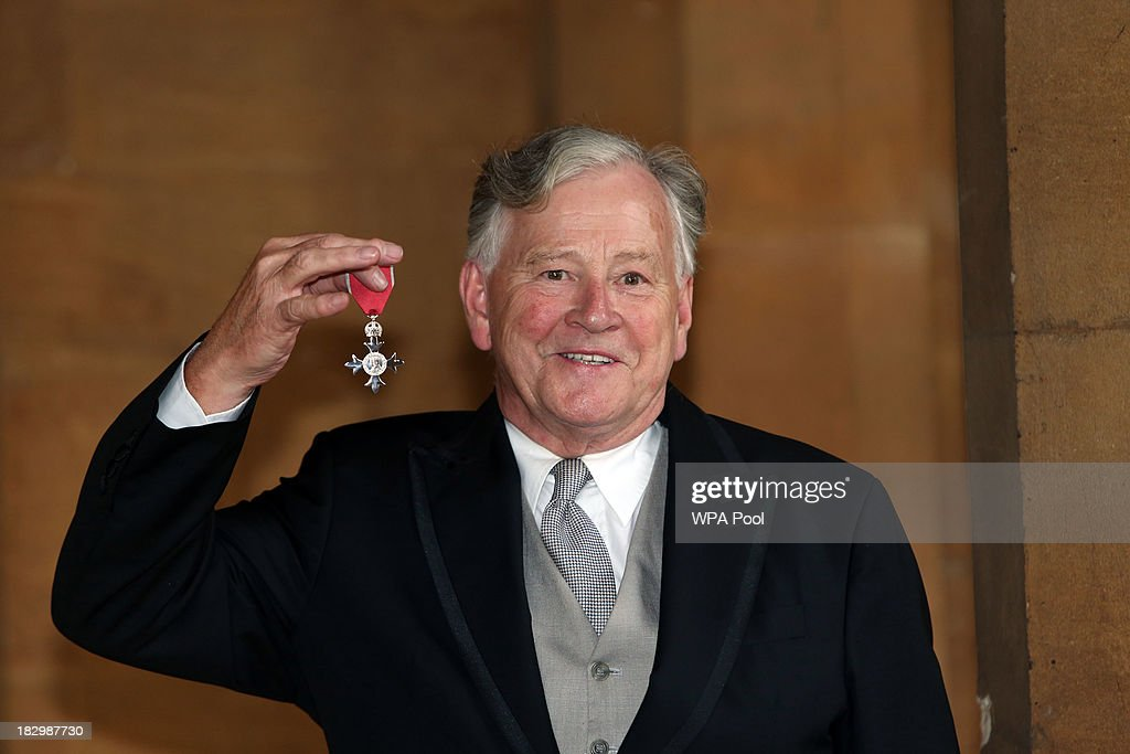 Christopher Duncan receives an MBE for services to International Business at Windsor Castle on October 3, 2013 in Widsor, England.