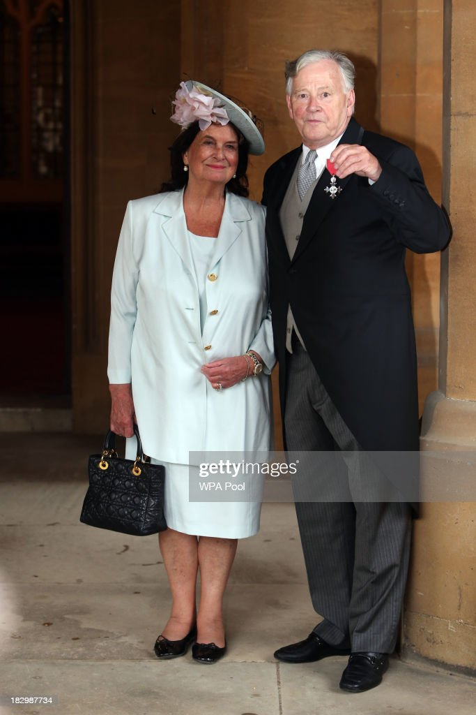Christopher Duncan with wife Ann, receives an MBE for services to International Business at Windsor Castle on October 3, 2013 in Widsor, England.