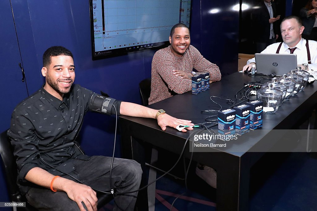 Christopher Elias, Carmelo Anthony and Daniel Ribacoff appear as Carmelo Anthony brings the heat in the Gillette Clinical Clear Gel Pressure Chamber, taking guys out of their comfort zones with polygraph test questions that will push their deodorant to its limit in Vanderbilt Hall at Grand Central Terminal on April 28, 2016 in New York City.