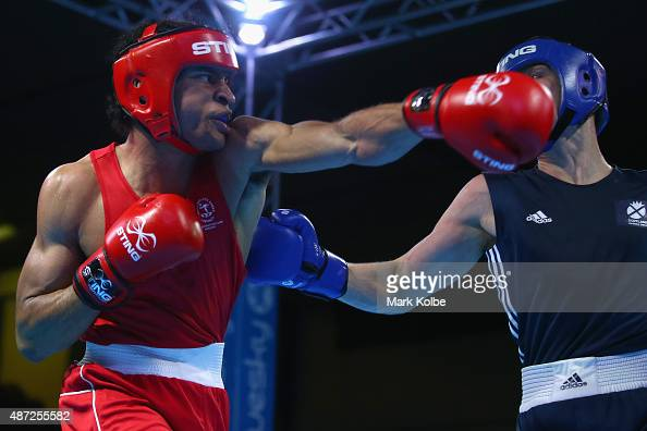 Christopher Enyi of Australia and John Doherty of Scotland box during their youths 75kg quarterfinal bout at the Tuanaimato Sports Facility on day...