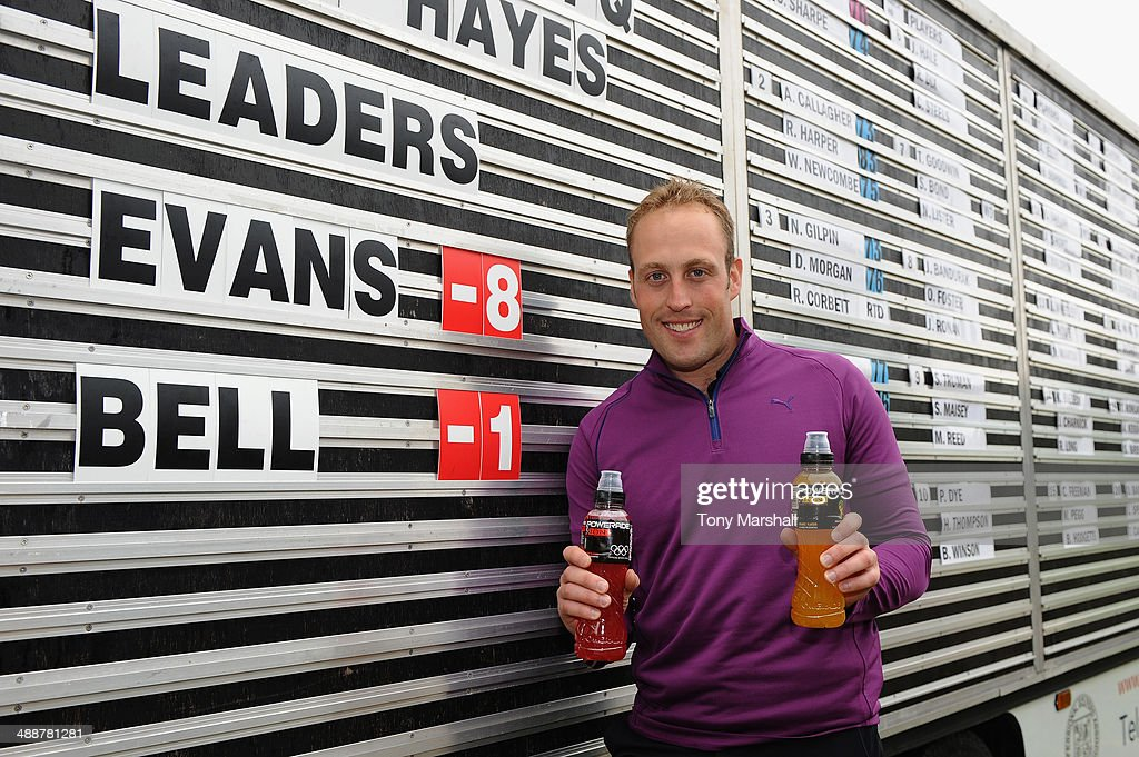 Christopher Evans of Wishaw Golf Club poses by the scoreboard with bottles of Powerade after winning the Powerade PGA Assistants' Championship - Midlands Regional Qualifier at The Pype Hayes Golf Club on May 8, 2014 in Birmingham, England.