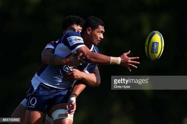 Christopher FeauaiSautia of Queensland Country offloads while tackled during the round five NRC match between Queensland Country and Melbourne at...