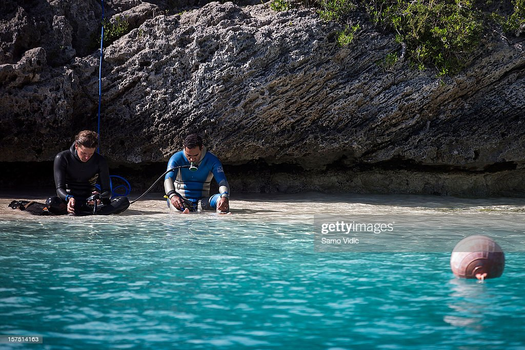 Christopher Friedrich of Austria (saftey diver) and Gustavo Buss of Brazil breath oxygen during the Suunto free diving world cup on November 26, 2012 in Long Island, Bahamas.
