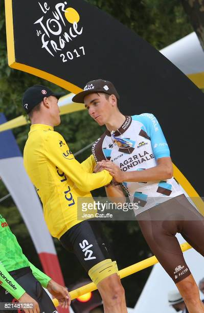 Christopher Froome of Great Britain and Team Sky greets Romain Bardet of France and AG2R La Mondiale during the trophy ceremony following stage 21 of...