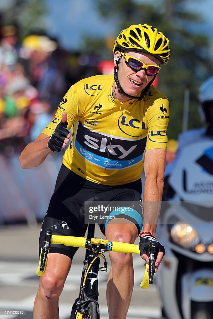 Christopher Froome of Great Britain and Team Sky Procycling celebrates as he crosses the finish line and secures the leader's yellow jersey during stage twenty of the 2013 Tour de France, a 125KM road stage from Annecy to Annecy-Semnoz, on July 20, 2013 in Annecy, France.
