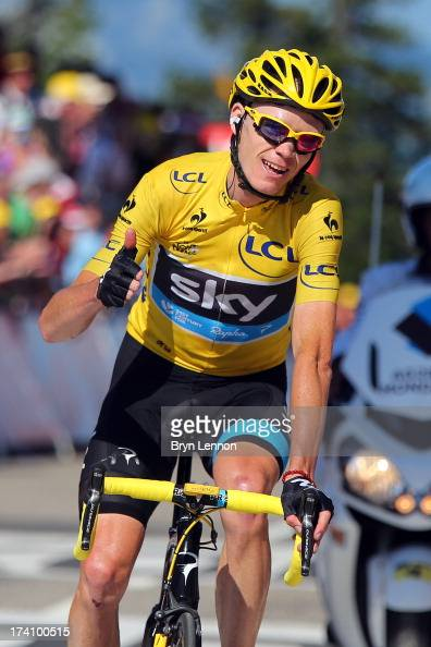 Christopher Froome of Great Britain and Team Sky Procycling celebrates as he crosses the finish line and secures the leader's yellow jersey during...