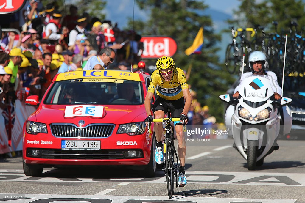 Christopher Froome of Great Britain and Team Sky Procycling crosses the finish line and secures the leader's yellow jersey during stage twenty of the 2013 Tour de France, a 125KM road stage from Annecy to Annecy-Semnoz, on July 20, 2013 in Annecy, France.