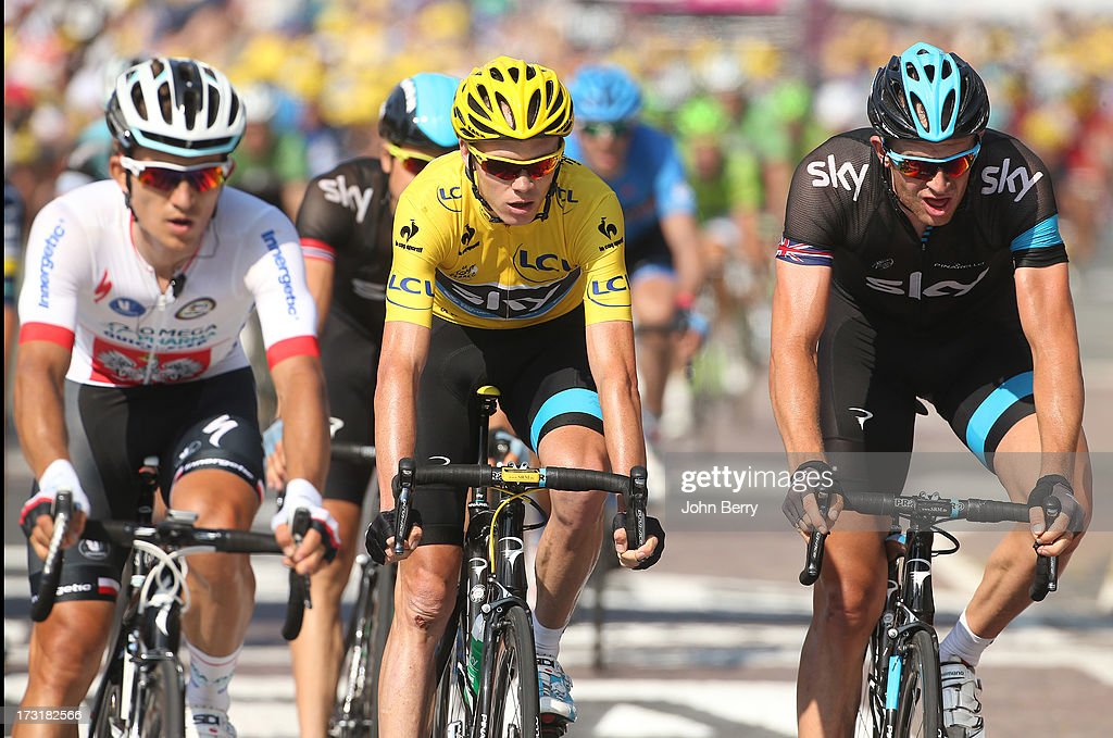 Christopher Froome of Great Britain and Team Sky Procycling - here between Michal Kwiatkowski of Poland and Team Omega Pharma Quick-Step and teammate <a gi-track='captionPersonalityLinkClicked' href=/galleries/search?phrase=Ian+Stannard&family=editorial&specificpeople=3472614 ng-click='$event.stopPropagation()'>Ian Stannard</a> of Great Britain - keeps the leader's yellow jersey after Stage Ten of the Tour de France 2013 - the 100th Tour de France -, a 197 km road stage from Saint-Gildas-des-Bois to Saint-Malo on July 9, 2013 in Saint-Malo, France.