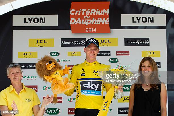 Christopher Froome of Great Britain and Team Sky wearing the yellow leaders jersey celebrates on the podium after winning the first stage an...