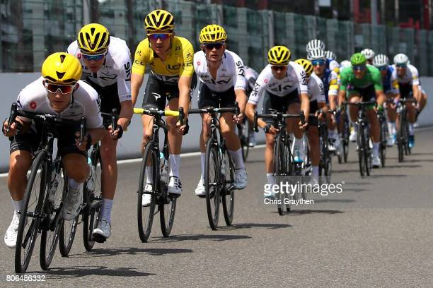 Christopher Froome of Great Britain riding for Team Sky and Geraint Thomas of Great Britain riding for Team Sky in the yellow leader's jersey rides...