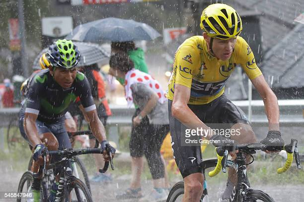 Christopher Froome of Great Britain riding for Team Sky and Nairo Alexander Quintana of Colombia riding for Movistar Team ride in heavy rain during...