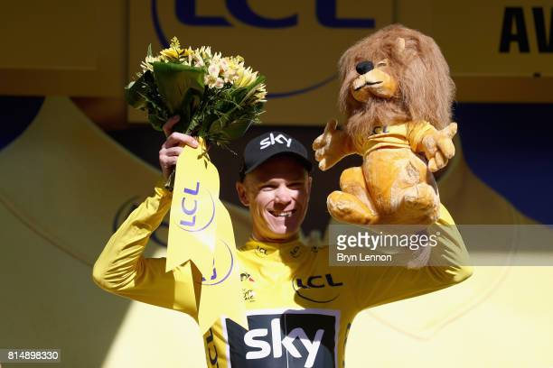 Christopher Froome of Great Britain riding for Team Sky celebrates retaining the yellow jersey after stage 14 of the Le Tour de France 2017 a 181km...