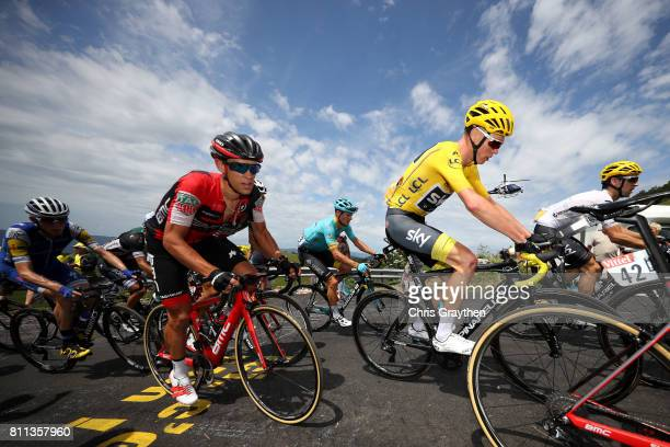 Christopher Froome of Great Britain riding for Team Sky in the leader's jersey and Richie Porte of Australia riding for BMC Racing Team ride in the...