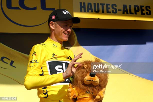 Christopher Froome of Great Britain riding for Team Sky in the leader's jersey poses for a photo on the podium following stage 18 of the 2017 Le Tour...