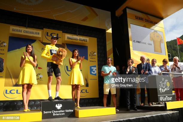 Christopher Froome of Great Britain riding for Team Sky in the leader's jersey stands on stage with French President Emmanuel Macron in attendance...