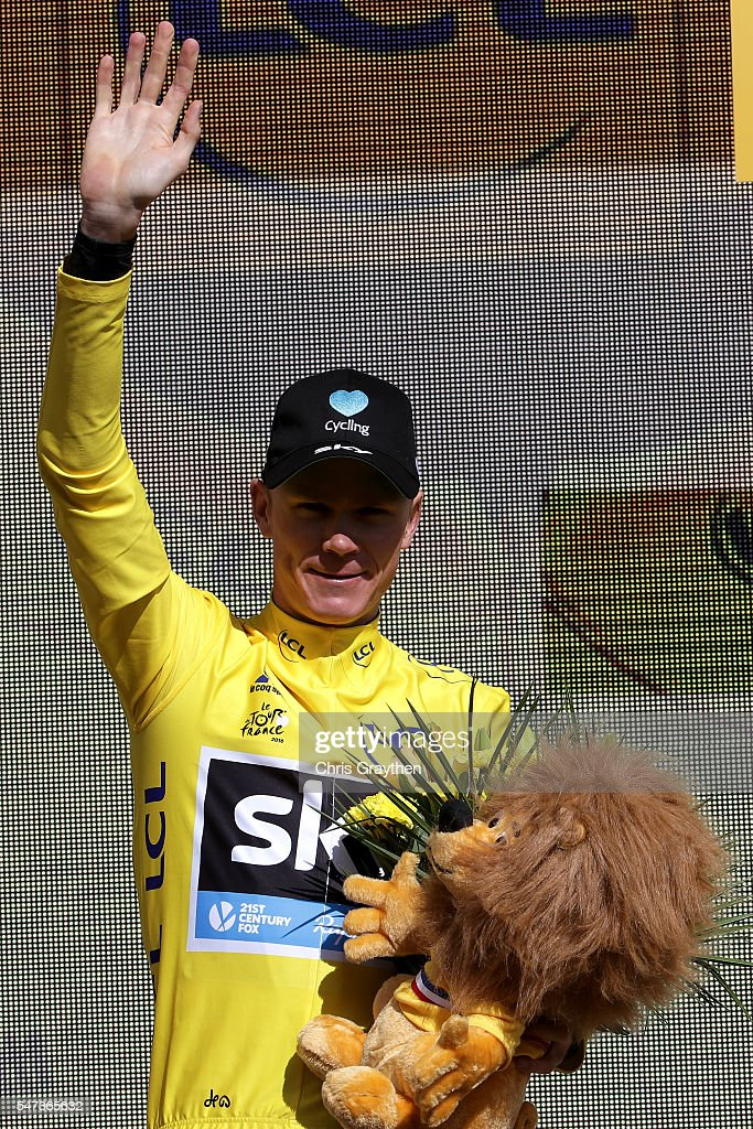 Christopher Froome of Great Britain riding for Team Sky in the yellow leader's jersey poses for a photo on the podium following stage twelve, a 178km stage from Monpellier to Chalet-Reynard near the Mont Ventoux on July 14, 2016 in Montpellier, France.