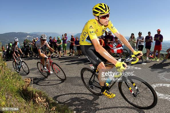 Christopher Froome of Great Britain riding for Team Sky in the yellow leader's jersey rides in the peloton up the Lacets du Grand Colombier during...