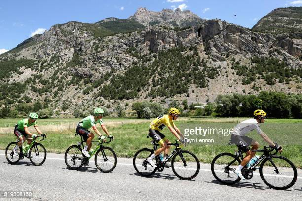 Christopher Froome of Great Britain riding for Team Sky in the yellow jersey rides with Mikel Landa of Spain riding for Team Sky Dylan Van Baarle of...