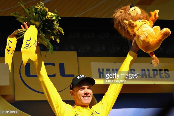 Christopher Froome of Great Britain riding for Team Sky is presented with the general classification yellow leaders jersey on the podium after stage...