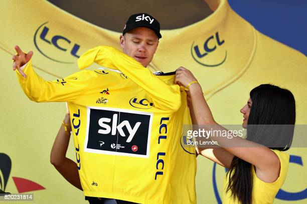 Christopher Froome of Great Britain riding for Team Sky is presented with the yellow jersey on the podium after stage nineteen of the 2017 Tour de...