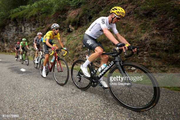 Christopher Froome of Great Britain riding for Team Sky leads Fabio Aru of Italy riding for Astana Pro Team in the leader's jersey Romain Bardet of...