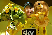 Christopher Froome of Great Britain riding for Team Sky takes the podium in the yellow leader's jersey following stage 16 of the 2016 Le Tour de...