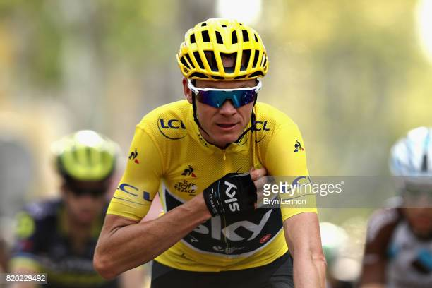 Christopher Froome of Great Britain riding for Team Sky wearing the yellow leaders jersey crosses the finish line on stage nineteen of the 2017 Tour...