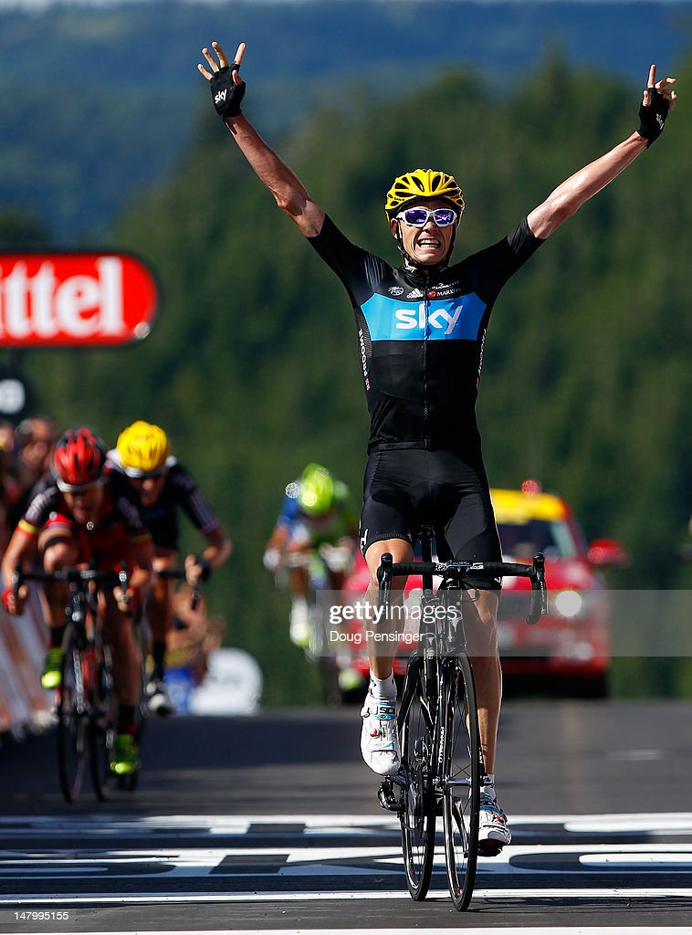 Christopher Froome of Great Britian riding for Sky Procycling celebrates as he crosses the finish line to win stage seven of the 2012 Tour de France...