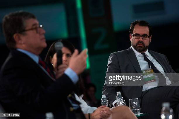 Christopher Garman head of country analysis for the Eurasia Group Ltd right listens during the UNICA Ethanol Summit 2017 in Sao Paulo Brazil on...