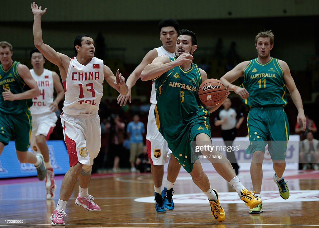 Christopher Goulding (L) of the Boomers brings the ball up the court with Xi Rilijiang of China during game three of the series between the Australian Boomers and China at Tianjin Sports Center on June 12, 2013 in Tianjin, China.